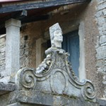 Stone head on gateway in Tinjan, Istria