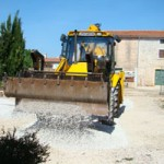 JCB spreading gravel in our drive, Istria