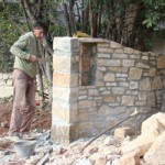 Stonemason crafting Kovaci property's beautiful gateway in Istria