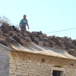 Roof tiles being replaced on barn in Kovaci, Istria