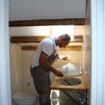 Miro installing shower-room sink in Kovaci, Istria