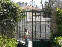 wrought-iron gateway to building site in Pula