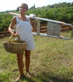 Marija with basket and step ladder, ready for picking