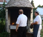 Alen & Snjezana prepare our beef peka in the outdoor oven