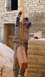 Toni lowering tiles to earth in Istria