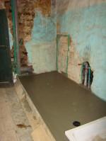 Concrete floor in family bathroom