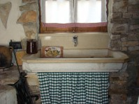 Traditional stone sink set into window sill in Kovaci, Istria