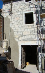 Part re-pointed and part plastered house facade at Kovaci, Istria
