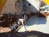 Miro smoothes the concrete for the pool base in Kovaci, Istria
