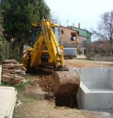 Backfilling by JCB around concrete pool in Kovaci, Istria