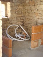 Half-built walls and pool plumbing in storeroom in Kovaci, Istria