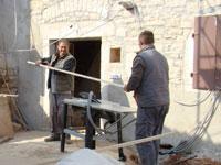Miro and Toni cutting a strip to cover a gap in Kovaci, Istria
