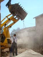 Toni cleaning his JCB engine in Kovaci, Istria