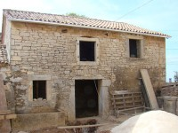 Front of Kovaci barn, Istria showing quirky window alignment