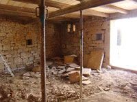 Downstairs in the barn in Kovaci with supporting props & lifted floor