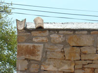 Two capping tiles in place on tall Kovaci wall, Istria
