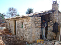 Stonemason rebuilding the missing shed wall in Kovaci, Istria