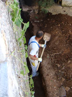 Amir digging behind the house in Kovaci, Istria