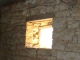 Opened up, the small square bathroom window in Kovaci, Istria