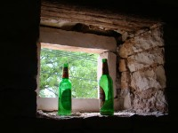 Sign builders are around - beer bottles in window at Kovaci, Istria