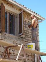 Amir re-pointing in the sunshine in Kovaci, Istria