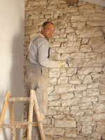 Amir cleaning out the old grouting in Kovaci, Istria