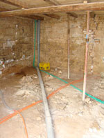 Ground floor of Kovaci barn with plumbing pipes, Istria