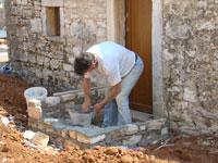 Stonemason creating entry to supa in Kovaci, Istria