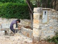 Stonemason working in garden, Kovaci, Istria