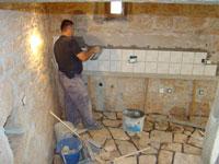 Sali tiles the barn's kitchen in Kovaci, Istria