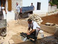 Miro lays drain while sofas arrive behind, Kovaci, Istria