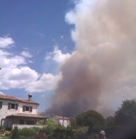 Smoke from the fire towering over our house in Istria