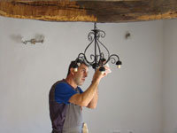 Putting up the chandelier in Kovaci, Istria