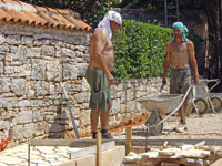 Amir & Miro paving with T-shirts on their heads in Kovaci, Istria