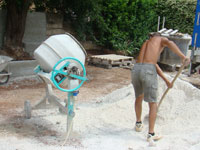 Amir loading the noisy cement mixer in Kovaci, Istria