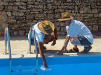 P gets instruction from the pool expert at Kovaci, Istria