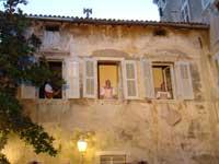singers sing from windows in Iustitia, Porec, Istria