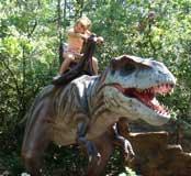 Emily riding a dinosaur, Dinopark, Istria