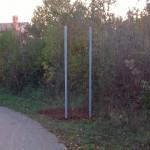 Blank poles outside village