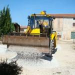 JCB spreading gravel in our drive, Istria