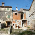 House exterior with awful, red-brick extension in Kovaci, Istria
