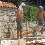 Miro & Amir pave with t-shirts on their heads in Kovaci, Istria